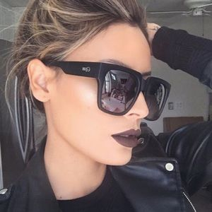 Quay black sunglasses on the prowl